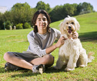 Teenager and his dog stock photos