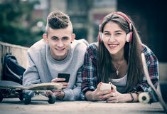 Teenager and his girlfriend with smartphones Royalty Free Stock Image