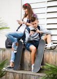 Teenager and his girlfriend with smartphones Royalty Free Stock Photo
