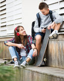 Teenager and his girlfriend with smartphones Stock Photo