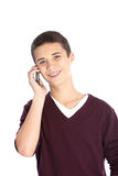 Teenager on his mobile phone. Studio portrait over white of a happy teenage boy chatting on his mobile phone Stock Images