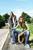 Teenager hitchhiking Royalty Free Stock Photo
