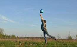 Teenager hits the ball. Sports on the open air. Stock Images