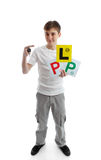 Teenager hold car key & learner licence plates. Full length teenager. He is holding a car key and various licence plate signs for learner drivers. White royalty free stock photos