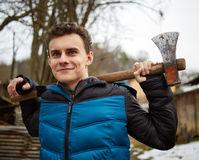 Teenager holding axes outdoor Stock Photo