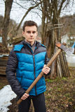 Teenager holding axes outdoor Royalty Free Stock Images