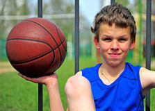 Teenager holding the basketball Royalty Free Stock Images