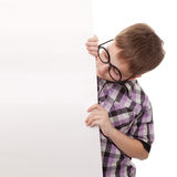 Teenager standing by white blank card. Teenager holding blank billboard sign Stock Photo