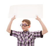 Teenager standing by white blank card. Teenager holding blank billboard sign royalty free stock image
