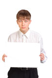 Teenager holding blank paper Royalty Free Stock Image