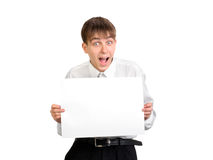 Teenager holding blank paper Royalty Free Stock Images