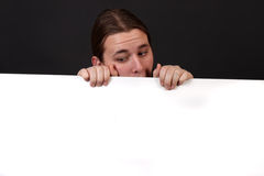 Teenager holding blank sign Royalty Free Stock Image