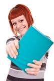 Teenager holding book Stock Photos