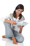 Teenager holding book and reading Royalty Free Stock Image