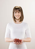 Teenager holding bowl of fresh grapes Stock Photo
