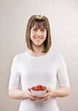 Teenager holding bowl of fresh raspberries Royalty Free Stock Photo