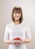 Teenager holding bowl of fresh raspberries Royalty Free Stock Photo