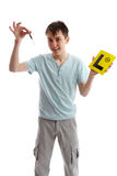 Teenager holding car keys and L plates Royalty Free Stock Image