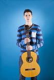 Teenager holding a classic guitar Royalty Free Stock Images