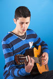 Teenager holding a classic guitar Stock Photo