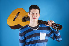 Teenager holding a classic guitar Stock Photos