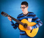 Teenager holding a classic guitar Royalty Free Stock Photography