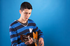 Teenager holding a classic guitar Royalty Free Stock Image