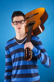 Teenager holding a classic guitar Royalty Free Stock Photo