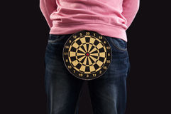 Teenager holding a dartboard with his hands Royalty Free Stock Photography