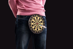 Teenager holding a dartboard with syringe in her Stock Photo