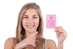 Teenager holding  driving license Royalty Free Stock Image