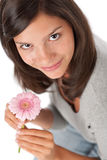 Teenager holding gerbera daisy Royalty Free Stock Photos