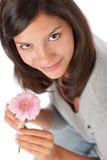 Teenager holding gerbera daisy Royalty Free Stock Photos