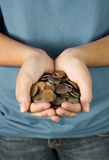 A Teenager Holding a Handful of Coins Stock Photo