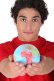 Teenager holding a mini globe Stock Image
