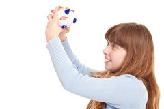 Teenager holding piggybank Royalty Free Stock Photos