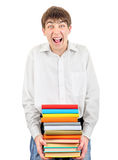 Teenager holding Pile of the Books Royalty Free Stock Image