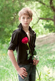 Teenager holding  rose in her hand, Stock Image