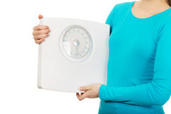 Teenager holding a scale. Stock Images
