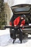 Teenager holding skis. Royalty Free Stock Photos