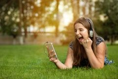 Teenager holding smart phone in hand, screams with joy and happiness stock photography