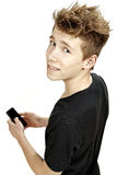 Teenager holding smartphone and smiles Stock Image