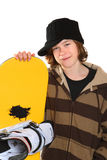 Teenager holding a snowboard Stock Photo