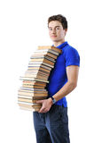Teenager holding stack of books isolated over white. Background Royalty Free Stock Photos