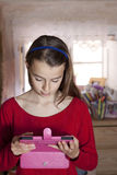 Teenager holding a tablet Royalty Free Stock Photo
