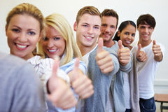 Teenager holding thumbs up Royalty Free Stock Photography