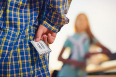 Teenager holding tickets for the cinema Royalty Free Stock Image