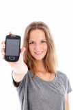 Teenager holding up a mobile phone Stock Photo