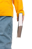 Teenager holds book in hand. On white background Royalty Free Stock Images