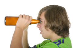 Teenager holds a bottle before eyes. On a white background Stock Photography